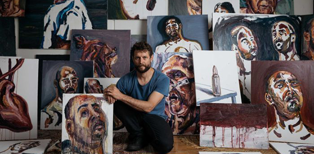 Ben Quilty with Myuran Sukumaran's paintings (photo by Daniel Boud)