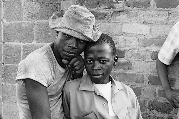 Young men with dompas (an identity document that every black South African had to carry), White City, Jabavu, Soweto 1972 silver gelatin photograph on fibre-based paper Image courtesy Goodman Gallery, Johannesburg and Cape Town © The David Goldblatt Legacy Trust