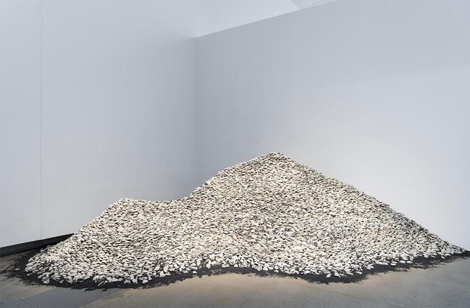 Megan Cope Australia, b.1982 RE  FORMATION (Noogoon/St Helena Island)  2016 -2019 Cast -concrete oyster shells, copper slag /  Dimensions  variable  Purchased 2019 with funds from the Contemporary  Patrons through the  Queensland Art Gallery | Gallery of  Modern Art Foundation Collection: Queensland Art Gallery | Gallery of Modern  Art Photograph: Installation view, GOMA , Brisbane, 2019 .   Photographer: Natas ha Harth, QAGOMA .  Images courtesy: The artist and THIS IS NO FANTASY, Dianne Tanzer  & Nicola Stein   © Megan Cope