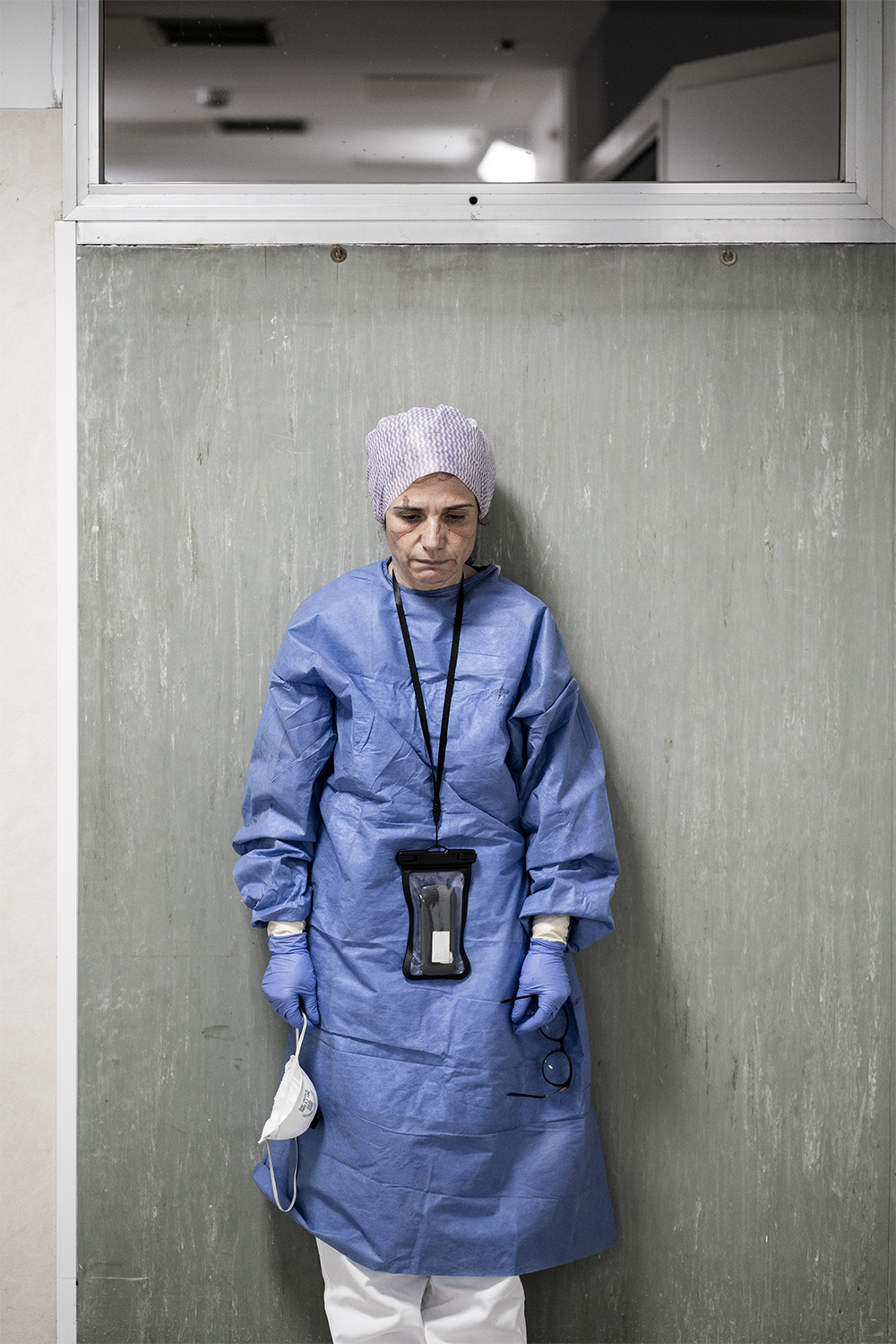 Margherita Lambertini, a first-aid surgeon doctor in Pesaro, Italy, at the end of a long shift. Italian photographer and journalist Alberto Giuliani took a series of photographs in the hospital.
