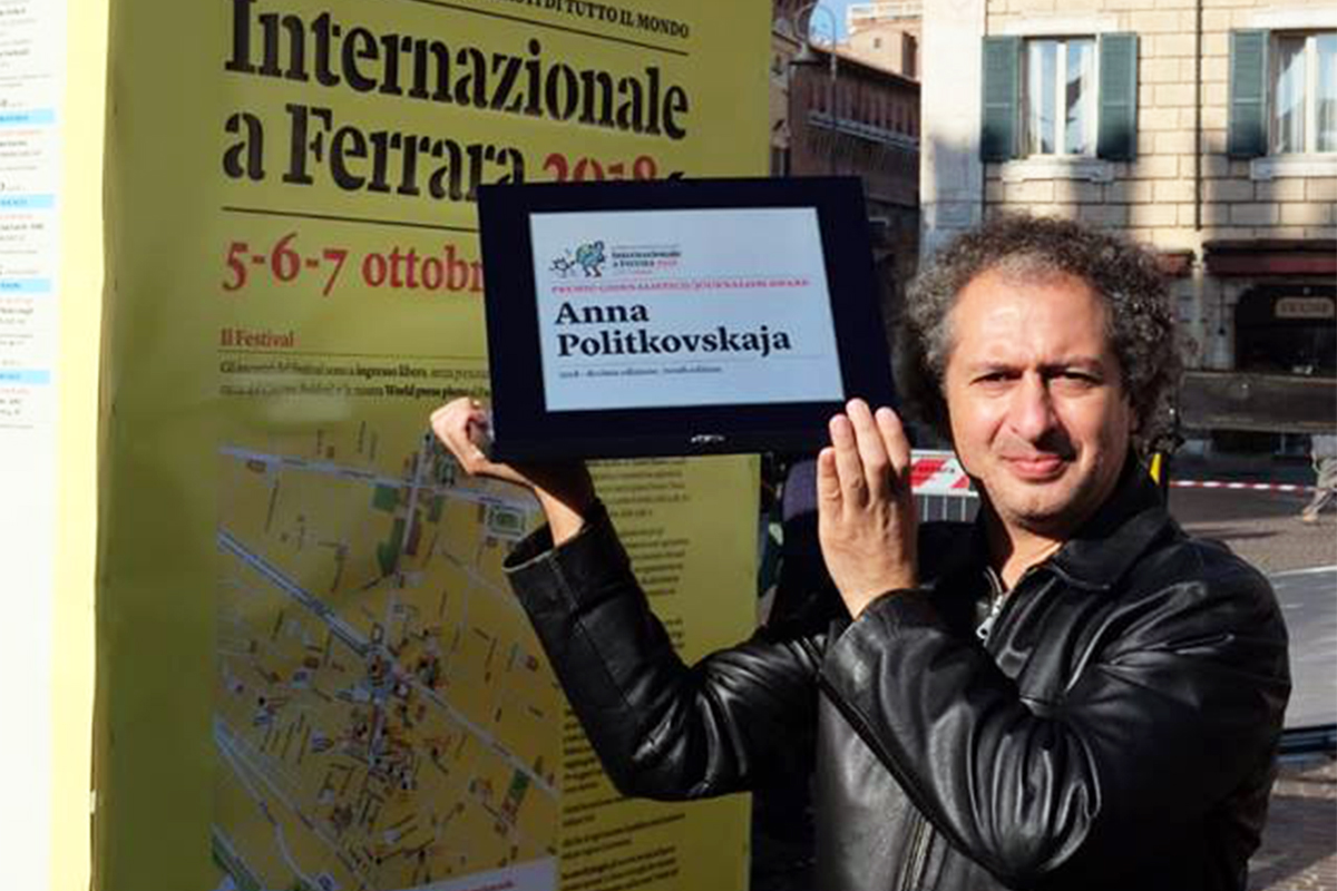 Omid Tofighian accepting Behrouz Boochani's Anna Politkovskaya Award at the Internazionale a Ferrara 2018 (photograph supplied)