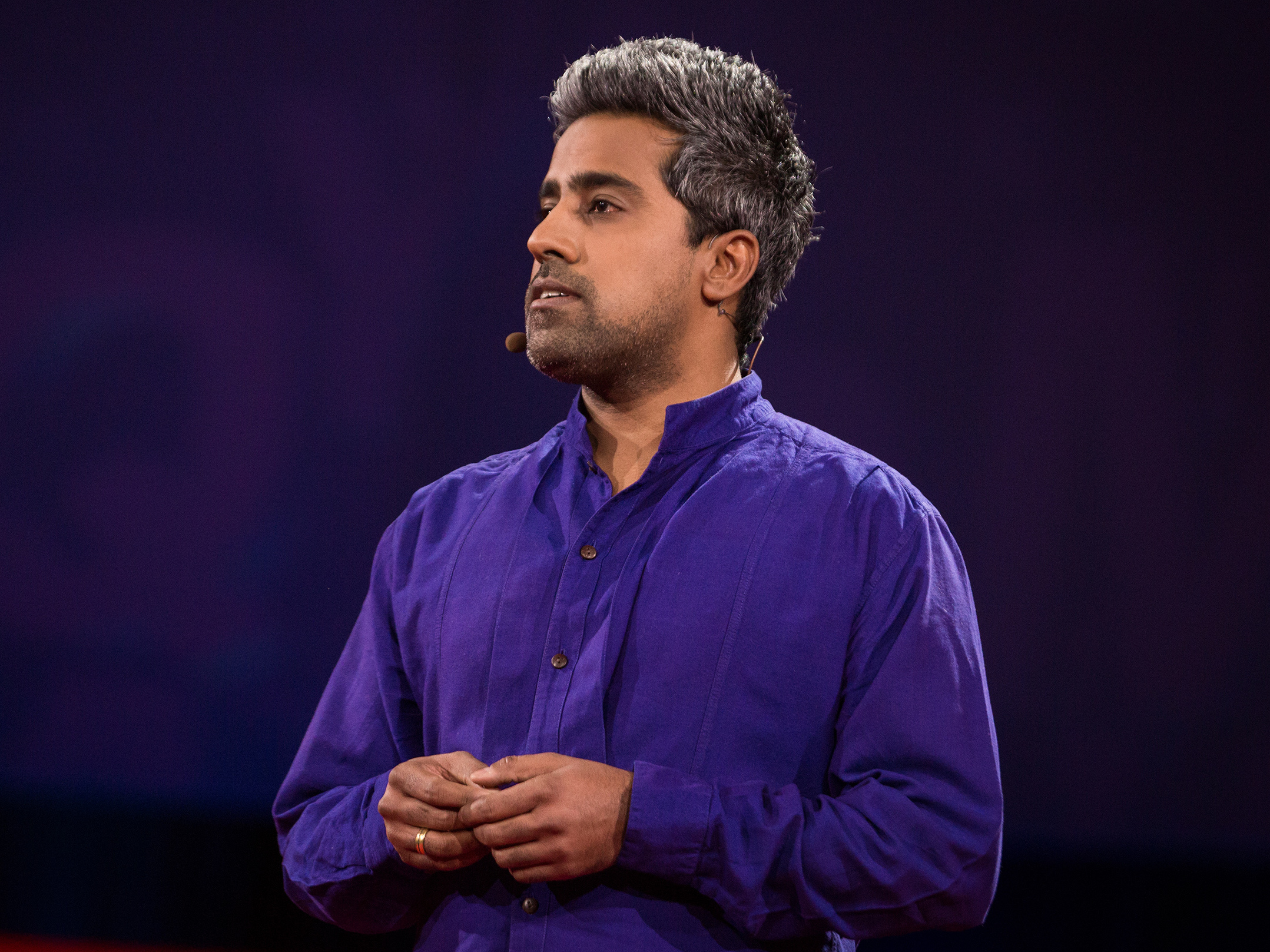 Anand Giridharadas performing his 2015 TED talk (photograph by James Duncan Davidson/TED)