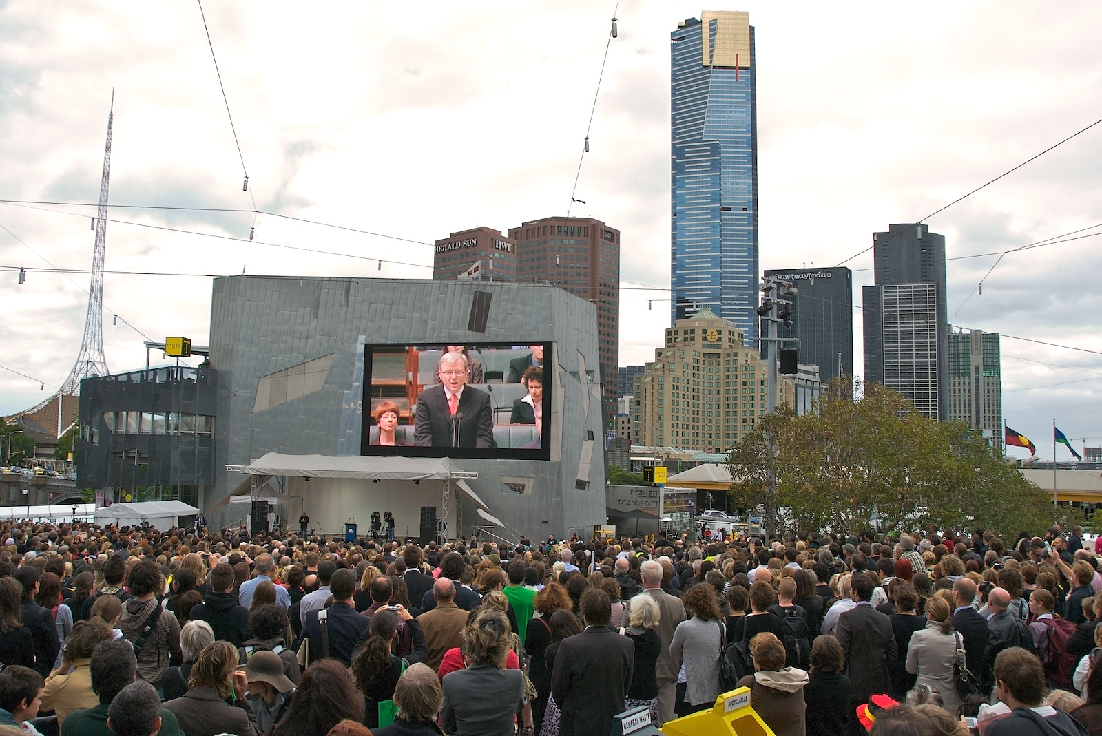 Prime Minister Kevin Rudd onscreen in Federation Square, Melbourne, apologising to the Stolen Generations