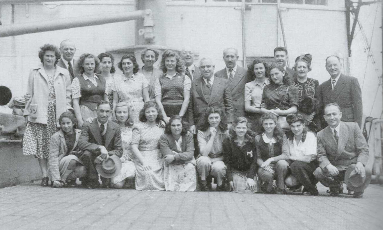A group of new arrivals with David Abzac centre, Fremantle, Western Australia, late 1940s