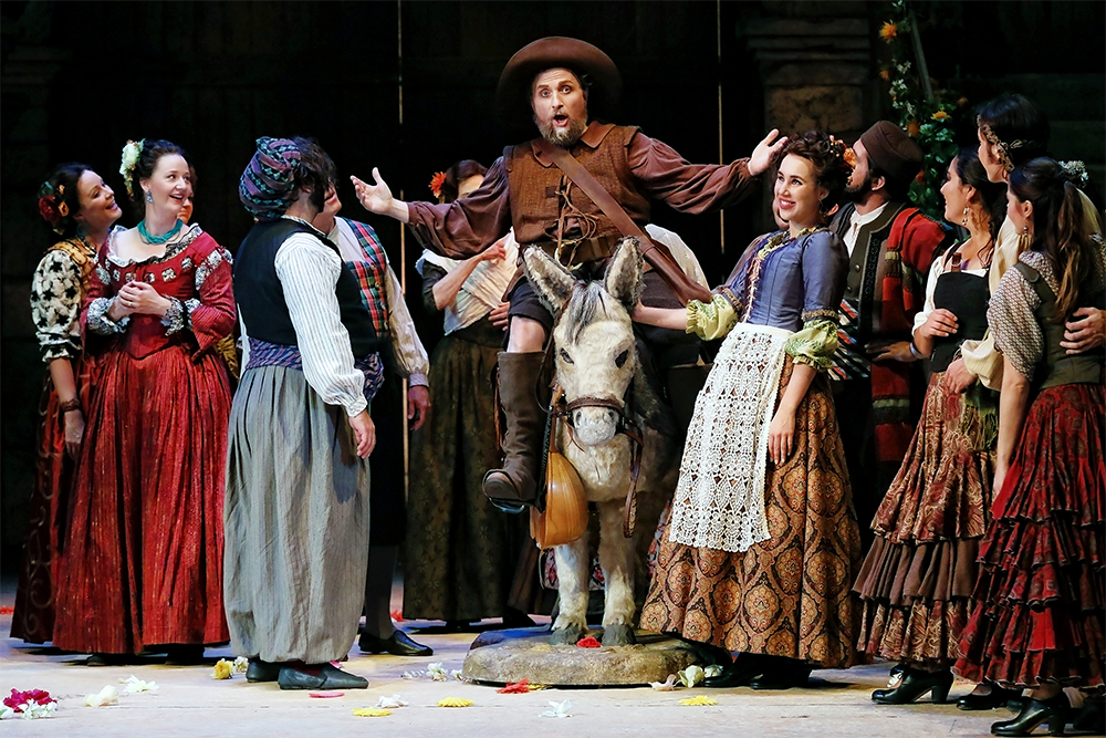 Warwick Fyfe as Sancho Panza and the chorus in Opera Australia's production of Don Quichotte (photograph by Prudence Upton)