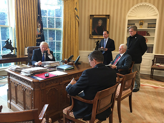 Donald Trump speaking with Vladimir Putin in the Oval Office