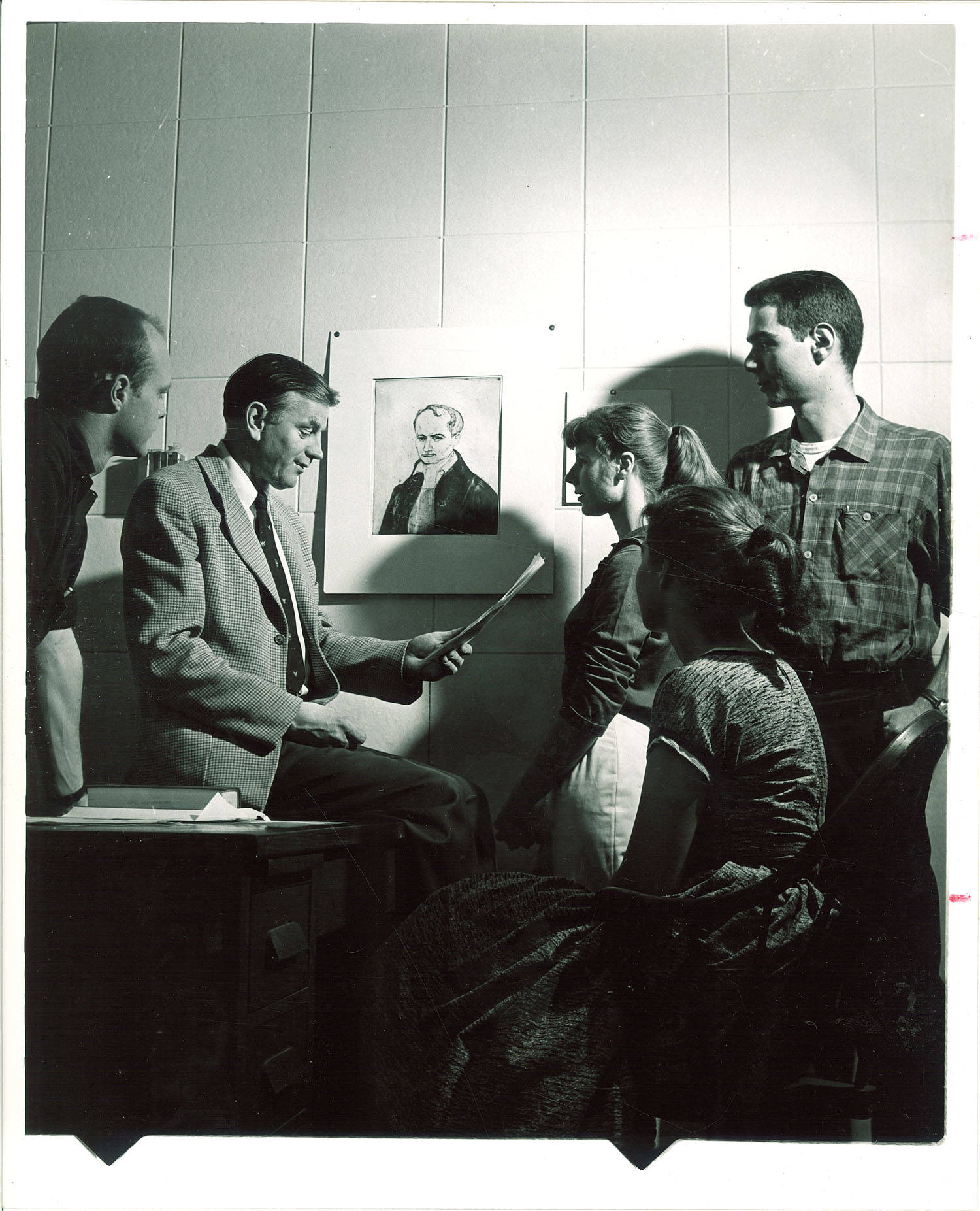 MFA Iowa Writers Workshop director Paul Engle with students The University of Iowa 1950s. Frederick W. Kent Collection / University of Iowa Archives