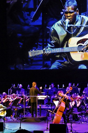 Gurrumul performs with the Sydney Symphony Orchestra as part of Vivid 2013 (photograph by Prudence Upton)